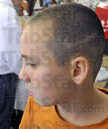 "Custom cut: Ten-year-old Devan Likin shows his ""swoosh"" provided by a custom haircut by John Stadler Monday afternoon."