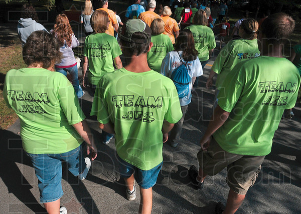 Tribune-Star/Joseph C. Garza<br /> For Jes: MS Walk participants and Team Jes members Sharon Rice, Brian Rice and Shawn King walk for family member, Jessica King, during the event Saturday at St. Mary-of-the-Woods.