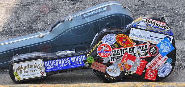 Tools of the trade: A pair of guitar cases rest along the curb on Wabash Avenue Saturday while their owners ply their trade onstage at the Blues at the Crossroads festival.
