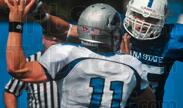 Tribune-Star/Joseph C. Garza<br /> Make them earn it, Dan: Indiana State defensive end Dan Millington rushes Eastern Illinois quarterback  Jake Christensen during the Sycamores' game against the Panthers Saturday at Memorial Stadium.