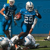 Tribune-Star/Joseph C. Garza<br /> Big return: Indiana State running back Darius Gates escapes the grasps of Eastern Illinois's Shelton Penrow and Cory Leman as he returns a kick return during the Sycamores' game against the Panthers Saturday at Memorial Stadium.