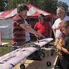 New wave: Rose-Hulman student Steven Riddle, in striped shirt, talks with Dennis Fritz(Rose Poly'68) about the electric powered airplane in front of him. With Fritz are his two grandsons Brian and Dennis MacDoanld, on the RHIT campus for Homecoming.