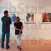 Tribune-Star/Joseph C. Garza<br /> Art to share: Mike Hannum and Denise Weltzin admire the art on display at Gopalan Contemporary Art as part of First Friday, Friday, Sept. 4.
