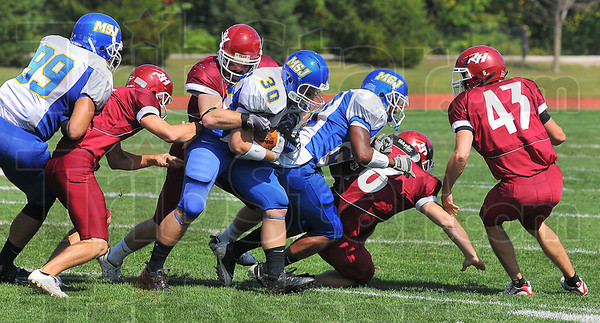 Tough to stop: Mount St.Joseph runingback Noah Joseph works for more yardage aganst RHIt defenders in firrst quarter action.