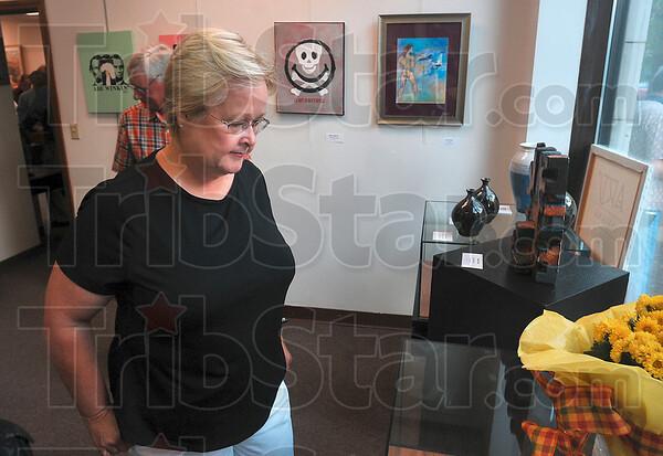 Tribune-Star/Joseph C. Garza<br /> Art to enjoy: Edie Dyer-Wilson enjoys the art pieces on display at Arts Illiana Friday, Sept. 4.