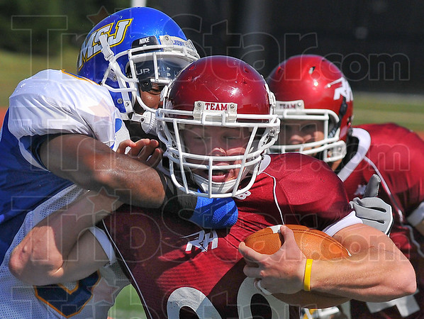 Every inch counts: RHIT runningback Kyle Kovach keeps running against the Lion defnse including Cory Hardin.