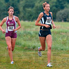 Tribune-Star/Joseph C. Garza<br /> Trading the lead: Terre Haute North's Tapring Goatee takes the lead from Culver Academy's Waverly Neer during the girls' race of the state preview meet Saturday at the Lavern Gibson course.