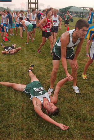 Tribune-Star/Joseph C. Garza<br /> A hand up: Westfield's Connor Love gives his teammate, Ethan Fry, a hand after they finished the boys' race of the state cross county preview meet Saturday at the Gibson course.
