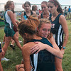 Tribune-Star/Joseph C. Garza<br /> Second place celebration: Terre Haute North's Tapring Goatee receives a hug from teammate Emily Cotterman after the girls' race of the state preview meet Saturday at the Gibson course. Goatee finished second.