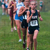 Tribune-Star/Joseph C. Garza<br /> Terre Haute North's Chanli Mundy leads the pack of competitors as they follow Culver Academy's Waverly Neer and North's Tapring Goatee during the girls' race of the state cross county preview meet Saturday at the Lavern Gibson course.