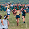 Tribune-Star/Joseph C. Garza<br /> A need for speed: Spectators crowd the edges of the Lavern Gibson championship cross country course as they watch the girls' race of the state cross country preview meet Saturday.