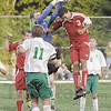 Got it: West Vigo goal keeper Ryan Martin snatches the ball of the header of South's #3, Ian Cook during Wednesday's match at the westside school.
