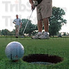 Close: Rea Park pro Dave Kennedy watches as his playing partner Scott Whittenburg comes oh so close to sinking a put during match action against frisbee golfers Zac Frame and Robert Sparks Wednesday evening.
