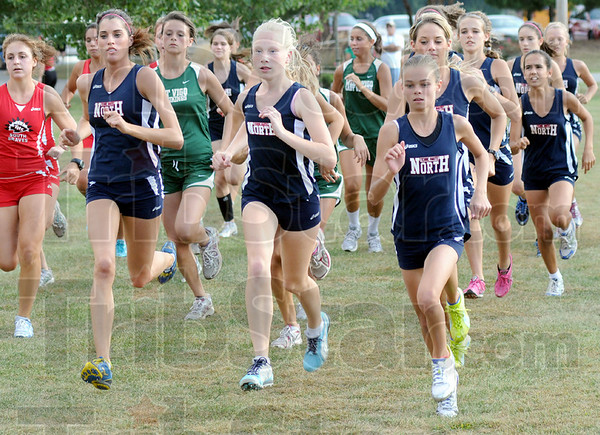 They're off: Girl's leave the starting line during Thursday's race at Rea Park.