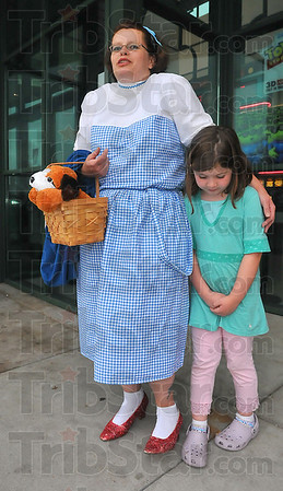 "And Toto too: Merry Miller, dressed as Dorothy brought her bosses' daughter Maria Casey to the special showing of ""The Wizard of Oz"" Wednesday evening."