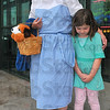 """And Toto too: Merry Miller, dressed as Dorothy brought her bosses' daughter Maria Casey to the special showing of """"The Wizard of Oz"""" Wednesday evening."""