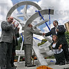 "Ribbon cutting: Dignitaries gather to cut the ribbon on the Michael Dunbar piece ""Arthur's Oddyssey"" Wednesday afternoon."