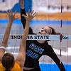 Tribune-Star/Joseph C. Garza<br /> Touch shot: Indiana State freshman Morgan Dall pushes the ball over the defense of UMKC's Kelly Gettinger during the Sycamores' match against the Roos Saturday during the Best Western Sycamore Classic at Indiana State.