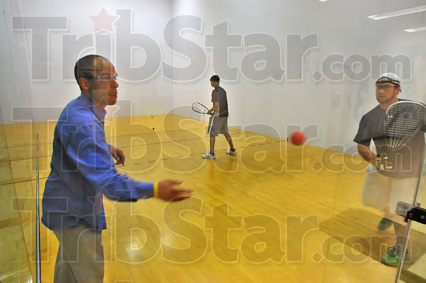 Practice: Manny Rodriguez works with Chris GArrett and Sean Jacob in Indiana State University raquetball courts Sunday evening.