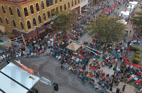 Tribune-Star/Joseph C. Garza<br /> Blues crowd: Blues at the Crossroads fans fill Wabash Avenue east of Seventh Street as they are entertained by Jill Shutt and her band Friday at the start of the festival.
