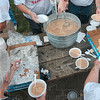 Tribune-Star/Joseph C. Garza<br /> Labor legumes: Volunteers dish out bowls of beans as by-standers grab them up (along with some crackers) during the bean dinner that followed the Labor Day Parade Monday at Fairbanks Park.