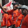 Tribune-Star/Joseph C. Garza<br /> Walking the walk: Actor Danny Glover, center, acknowledges applause from attendees of the Labor Day Parade Monday on Wabash Avenue. Glover was walking with members of Workers United.