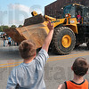 Tribune-Star/Joseph C. Garza<br /> Hello! Any candy?: Nicholas, 9, and Caleb Shaffer, 6, wave to big machinery as they wait with candy bags at the ready Monday during the Labor Day Parade on Wabash Avenue.