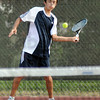 Slice: Terre Haute North's Nick Roby hits a shot during match action Tuesday night against South.