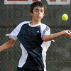 Action: Terre Haute North's Nick Roby returns a shot from his opponent during Tuesday's match against Terre Haute South.