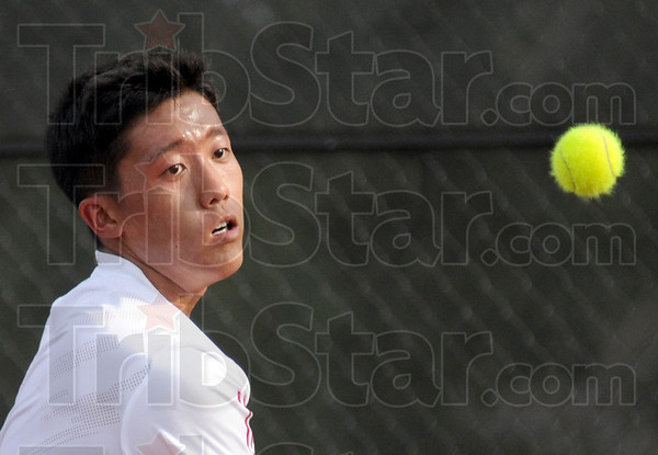 Luvable fuzzball: Terre Haute South's Andrew Huh keeps his eye on the ball during a match against North's Nick Roby Tuesday night.