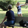 """Hot shot: Ten-year-old Dana Cottrell performs some """"cheers"""" for her grandmother Paulette Cottrell at Collett Park Tuesday afternoon. Dana is a Rosedale Elementary School 5th grader."""