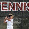 Huh hit: Terre Haute South's #1 tennis player Andrew Huh hits a backhand during match action against North's Nick Roby Tuesday evening.