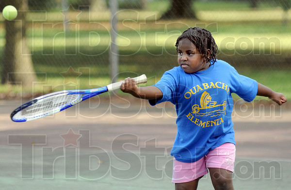 Lesson: Six-year-old Kayleiss Hutchinson makes contact during a tennis lesson at Collett Park Tuesday afternoon.