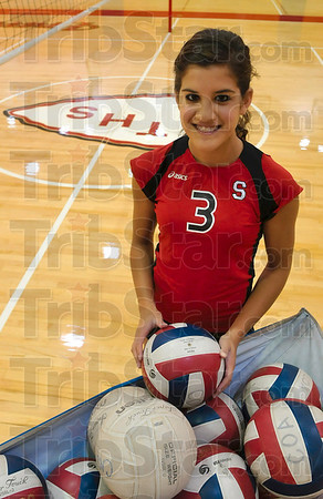 Tribune-Star/Joseph C. Garza<br /> Coming together: Terre Haute South senior Larina Coutinho, 17, is leading a fundraising volleyball match between her South Braves and the Terre Haute North Patriots to raise funds for newborns in the Union Hospital neonatal intensive care unit or NICU.