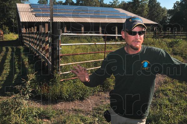 Tribune-Star/Joseph C. Garza<br /> A radiant energy source: One Planet Solar President Phillip Roberts talks about his company's latest solar system installation at Dr. Harold Loveall's home Tuesday in southern Vigo County.