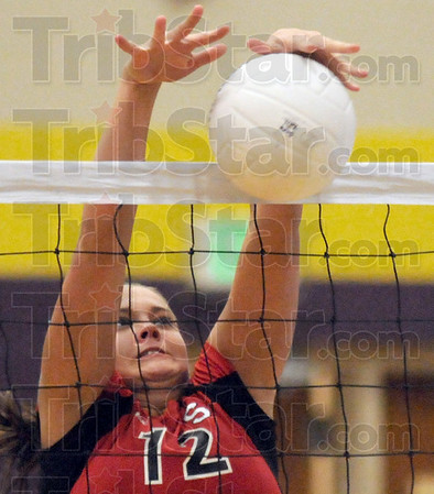 Stuffed: South's #12, Taylor Hayne stuffs a ball during match play against Sullivan Tuesday evening at the Sullivan gym.
