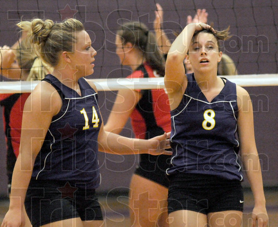 Shake it off: Sullivan's #14, Brekiesha Weszely consoles #8, Kelsey Lane after losing a point during match action against Terre Haute South Tuesday night at the Sullivan gym.