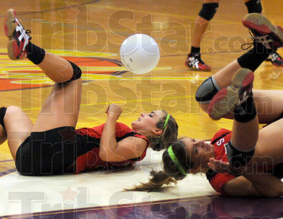 Tumbling twosome: South's #8, Rayna Gordon and #7, Macy Toon dive for a ball during match action against Sullivan Tuesday evening.