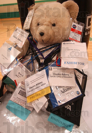 Badge Bear: A stuffed bear holds the numerous ID badges Adams has collected over the course of her studies and association with NASA. She used it as an object lesson on how one should never stop learning.