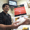 Pick-up: Casey Baesler delivers a deli order Tuesday morning at Baesler's Market. The store is utilizing a new method for deli orders that allows customers to input their order and continue shopping. When the order is ready they are notified by a text message or cell phone call.
