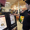 Deli demo: Casey Baesler operates the Boar's Head Express deli order machine at the entrance to the store Tuesday morning.
