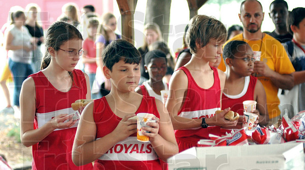 Hot diggity dog: Chauncey-Rose student athletes line up for a hot dog and drink at Tuesday's Royal Pride Party.