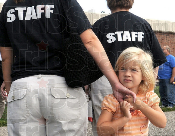 Security: Five-year-old Elli Davis holds tight to her mother Amanda during Tuesday's Royal Pride Party event. Amanda is a staff member of the school.
