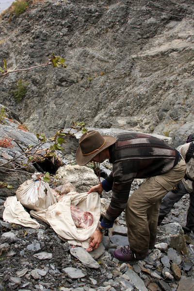 The meat from Jason's sheep is packed up in bags in preparation for hoisting it out of the canyon.