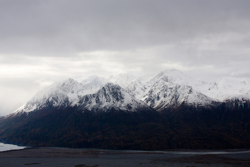 The tip of the Knik Glacier peeks into this photo of the far side of the Knik River Valley.