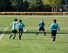 Benjamin goes for the ball, Ethan and Simon to the right