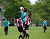 Will jumps for a header, Benjamin and Octavio to the sides
