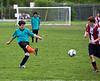 Grant kicks the ball, Jonah standing behind