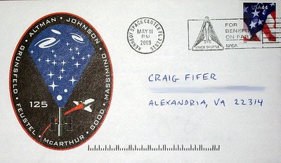 A commemorative event cover featuring a cachet of the STS-125 mission insignia, and bearing a pictorial cancellation by a postal unit at the Kennedy Space Center during the launch.