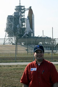 Craig in front of Space Shuttle Atlantis on Launch Pad 39-A